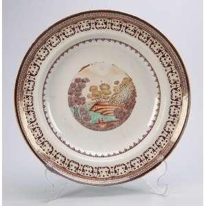 Prato de porcelana Cia das Índias, pertencente ao Serviço da Vista Grande, que teria sido de uso de <br />D. João VI na fazenda de Santa Cruz. 25 cm de diâmetro. China, Qing Qianlong (1796-1820).