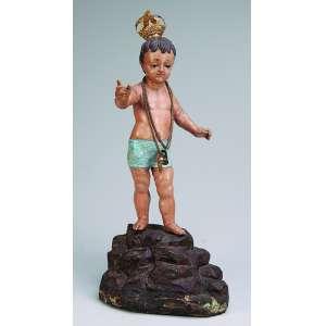 Menino Deus sobre rochedo<br />Esculpido em madeira patinada. Apresenta-se com coroa e corrente com sandálias em ouro. <br />43 cm de altura. Brasil, séc. XIX. Reproduzido em Menino Deus da Bahia.