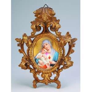 Nossa Senhora com o Menino<br />Pintura sobre porcelana. Moldura de madeira entalhada e dourada. 25 x 18 cm. Itália, séc. XIX. <br />(pequeno restauro na lateral direita).