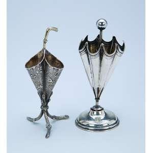 Dois paliteiros de prata, guarda-chuvas, teor 800. 12 cm de altura cada. Europa, séc. XX.