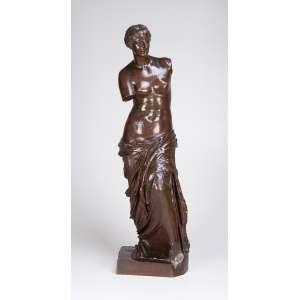 Vênus de Milo. Escultura de bronze patinado. 86 cm de altura. Apresenta carimbo e marca da fundição <br />F. Barbedienne. França, c. 1900.
