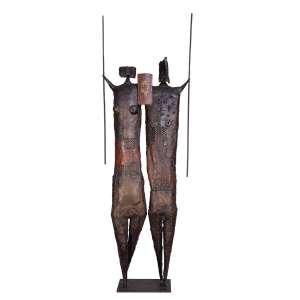 FRANCISCO STOCKINGER<br />Duas figuras. Escultura de metal patinado.Siglado na base.150 cm de altura.