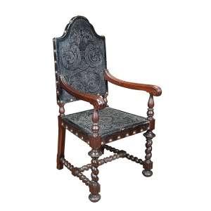 Poltrona de jacarandá torneado estilo manoelino, assento e encosto revestido de sola lavrada e tacheada. 119 cm de altura, o espaldar. Portugal, séc. XIX.