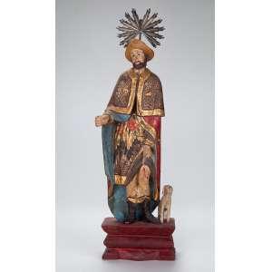 São Roque. Imagem de madeira, fatura ingênua, policromada e dourada com resplendor de prata. <br />33,5 cm de altura. Brasil, séc. XIX/XX.