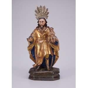 São José de Botas. Imagem de madeira dourada e policromada, segurando o Menino no braço esquerdo. <br />Resplendor de metal amarelo. 20 cm de altura, sem o resplendor. Brasil, séc. XIX.