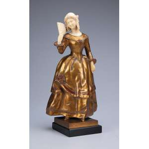 MONTIM<br />Dama com leque. Escultura de bronze e marfim, sobre base de ônix. 32 cm de altura. Assinada na base de bronze.