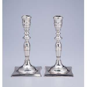 Par de castiçais de prata fundida e lisa. 23,5 cm de altura. Marca do teor 833. <br />Brasil, séc. XIX. (defeitos na bobèche).