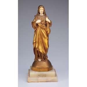 ALONZO, Dominique<br />Sagrado Coração de Jesus. Escultura de bronze e marfim sobre base de ônix. <br />33 cm de altura. França, c. 1930.