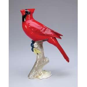 Pássaro vermelho. Estatueta de porcelana. 17,5 cm de altura. Marca da manufatura <br />Lorenz Hutschenreuther de Selb. Alemanha, séc. XX.