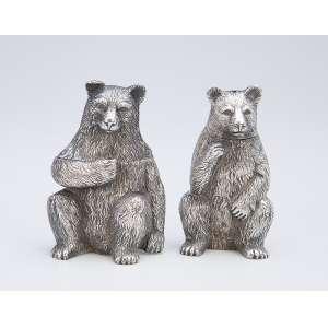 BUCCELATTI<br />Casal de ursos moldados em prata. 7 cm de altura. Itália, séc. XX.