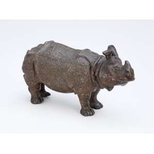 Rinoceronte. Escultura de bronze patinado. 15 x 8 cm de altura.