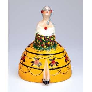 Night light. Figura feminina moldada em porcelana com policromia. 16,5 x 23 cm. <br />Sob a base marca da manufatura Etling - Paris. Séc. XX.