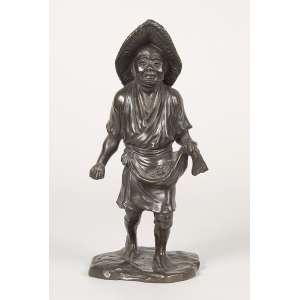 Agricultor. Escultura de bronze patinado. 20,5 cm de altura. <br />Assinado na base. Japão, séc. XX.