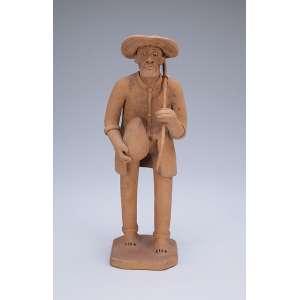 LUIZ GALDINO<br />Camponês. Escultura em barro cozido. 26,5 cm de altura. Assinada.