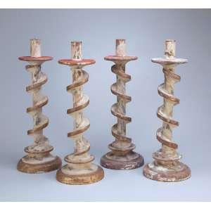 Conjunto de quatro tocheiros de madeira patinada e dourada, fuste em espiral. <br />60 cm de altura. Brasil, séc. XIX.