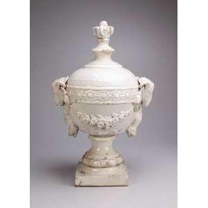 Pinha de louça branca, formato globular, ornada por cabeças de caprino. <br />68 cm de altura. Portugal, séc. XIX.