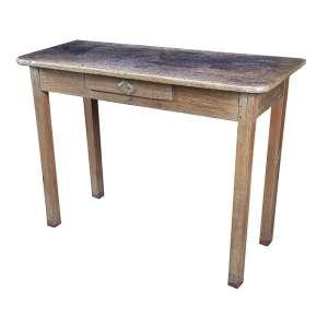 Mesa de encostar, retangular caixa com uma gaveta frontal. <br />109 x 45 x 83 cm de altura. Brasil, séc. XIX.