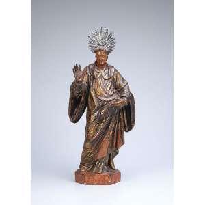 Imagem religiosa portando espada, madeira policromada. Resplendor de prata. - 36 cm de altura. - Brasil, séc. XIX.