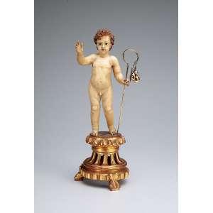 Menino Jesus. Escultura de madeira policromada e dourada com olhos de vidro. Apresenta-se <br />com cajado de prata. Base pedestal de madeira dourada. 34,5 cm de altura. Brasil, séc. XIX.