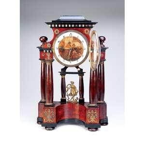 Relógio de mesa com mostrador circular e painel com pintura de cena de taberna. Apresenta-se suspenso em pórtico de madeira com ornamentos de metal dourado. 33 x 12 x 50 cm de altura. Europa, séc. XIX.