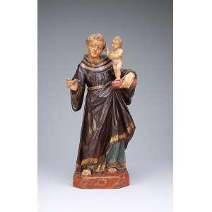 Santo Antonio Imagem de madeira patinada e dourada, de ótima manufatura. O Menino Jesus é de constituição robusta, panejamentos com mangas dos braços projetadas para baixo. 48 cm de altura. Brasil, séc. XVIII.