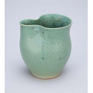 Pequena jarra de porcelana celadon. 8 cm de altura. China, séc. XX.