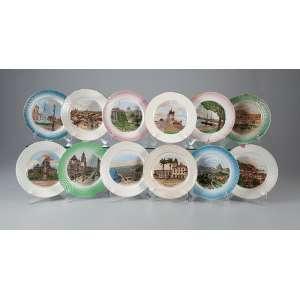 Coleção de 12 pratos de louça, decorados com paisagens iconográficas, policromados. <br />17,5 cm de diâmetro. Brasil, séc. XIX/XX. (alguns com trincados e fios de cabelo).