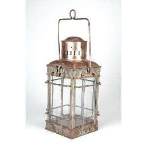 Antiga lanterna de metal com adaptação para luz elétrica. <br />40 cm de altura. Brasil, séc. XIX.