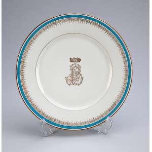 BARÃO DE PIRACICABA <br />Prato raso de porcelana, borda com filete azul e lanças douradas. Na caldeira, monograma do titular. <br />23 cm de diâmetro. França, Paris, séc. XX.