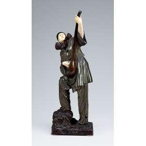 CHIPARUS, Demétre <br />Pierrot. Escultura de bronze patinado e marfim sobre base de bronze. 42 cm de altura. <br />Assinado na base. França, circa de 1930. <br />Reproduzido em Art Deco end other Figures, de Bryan Catley, Pág. 76.