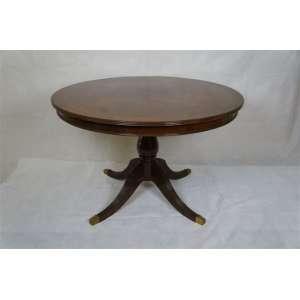 Mesa circular de madeira , tampo marchetado ,detalhes em bronze nos pés.