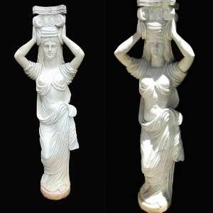 Par de esculturas executadas em mármore representando figuras femininas. (no estado)- 163 cm de alt.