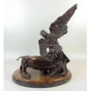 Grupo escultórico em bronze - 64 cm de alt, 44 de comp e 37 de prof.