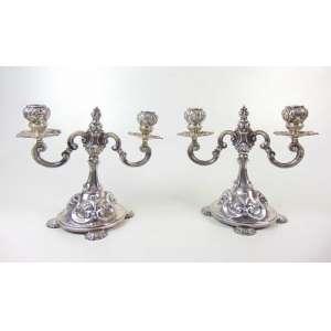 Par de candelabros baixos de prata de lei - 20 cm de alt, 24 de comp e 15 de prof.
