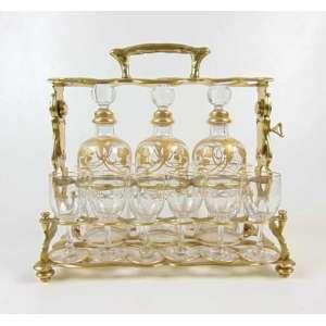 Licoreira de bronze com 3 decanters em cristal decorados a ouro e 12 copos no estilo e época Art Noveaux .França Séc XIXXX- 29 cm de alt, 28 x 17 cm.