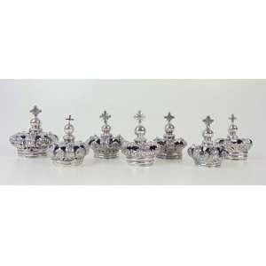Delicada coleção de 7 coroas de prata de lei repuxada estas de extrema qualidade. Brasil Séc XIX - Maior com 8 cm de alt e 8 de diâm.