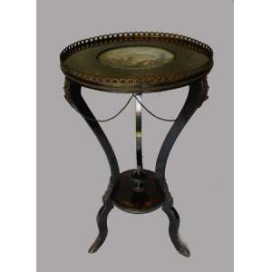 Mesa redonda de madeira com marchetaria e aplicações de metal, galeria fenestrada, prato central de porcelana com desenho de paisagem, altura 78cm e 45cm de diâmetro.