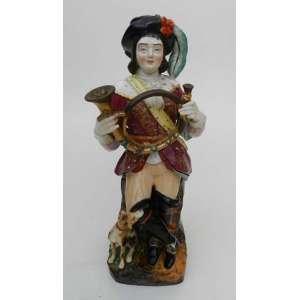 Figura de porcelana de Vincennes, representando cavalheiro com corne ingles e cachorro.Para velas.Apresenta dano na tampa.alt. 34 cm.