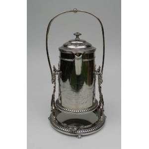 Chocolateira de metal espessurado a prata, WMF, com suporte e alça,sendo o interior de porcelana. altura 45cm e 25cm de diâmetro.