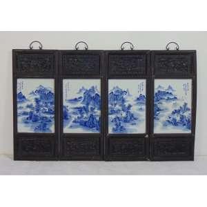 Conjunto de 04 placas de porcelana esmaltada decoração blue and white , guarnecidas por moldura em madeira entalhada - séc. XIX - China - 35 X 24 cm.