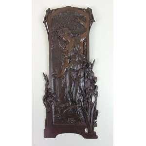 Placa de Bronze representando figura feminina - 56 x 25 cm.
