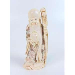 Escultura representando Sabio executado em Marfim policromado . China Sec XX - 12 cm alt.