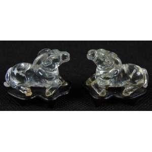 Par de delicados Cavalos executados em cristal de rocha. China Séc XX - 2,5 cm alt, 4 cm comp, 2 cm de prof.