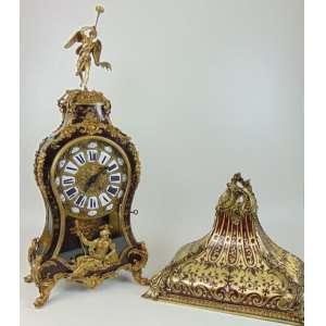 Relógio em tartaruga e boulle - mostrador em esmalte , acompanha respectivamente sua peanha - França séc. XIX.