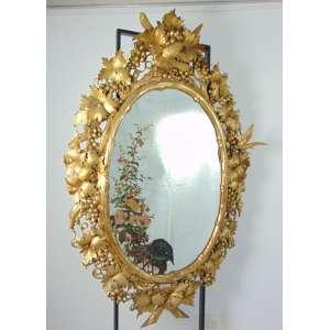 Importante espelho de madeira lavrada dourada ornamentado por pássaros . Veneza Séc XIX.- 1,83 x 1,20 cm.