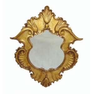 Espelho de madeira lavrada e dourada estilo Barroco Brasil Séc XX - Oval 110 x 90 cm.