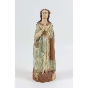 Santa em Madeira de lei esculpida e policromada . Brasil Sec XIX- 14 cm diâm, 39 cm alt.