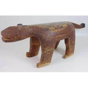 Arte Indígena - banco em madeira entalhada e pintada representando uma anta - 39x105x28 cm.