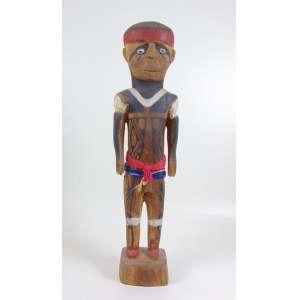 Arte Indígena - Lutador de Huka - Huka - etnia Mehinako - Alto Xingú - madeira entalhada, policromada com pigmentos naturais, fios de algodão e miçangas - 73 x 18 x 12 cm.