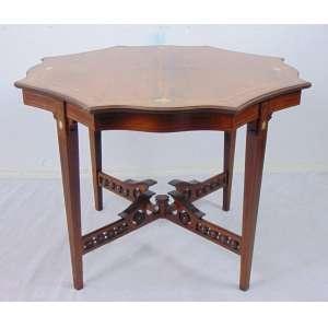Elegante mesa de linhas oitavadas com delicado trabalho de marcheteri em madeira e marfim ao gosto Adans . Inglaterra Sec XIX - 69 cm alt, 87 cm diâm.